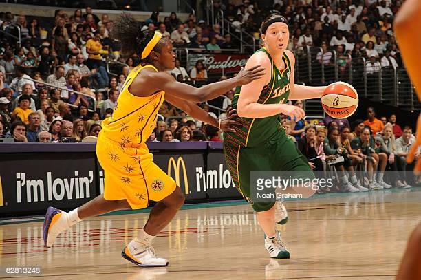 Katie Gearlds of the Seattle Storm drives to the basket past Marie FerdinandHarris of the Los Angeles Sparks on September 14 2008 at Staples Center...