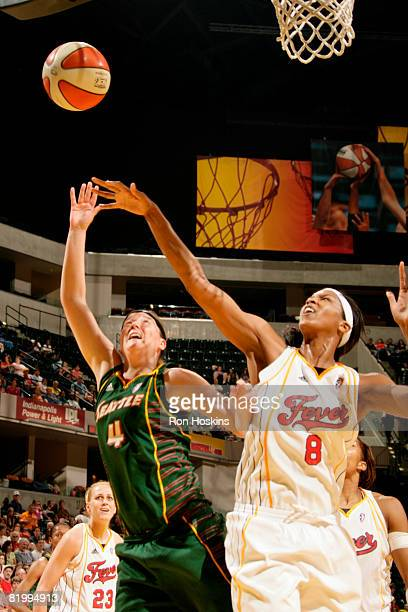 Katie Gearlds of the Seattle Storm shoots over Tammy SuttonBrown of the Indiana Fever at Conseco Fieldhouse on July 18 2008 in Indianapolis Indiana...