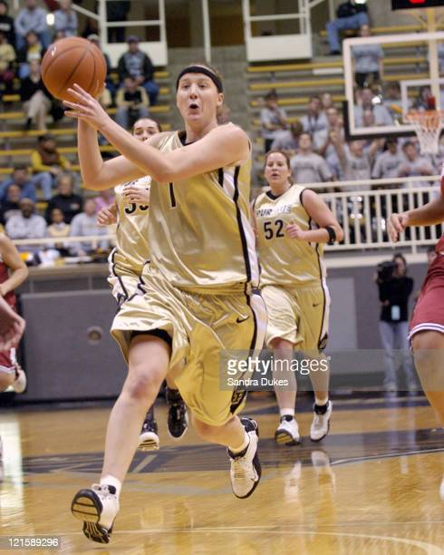 Katie Gearlds passes the ball as she goes up count in the second half of the game against Indiana at Mackey Arena West Lafayette Indiana on January 4...
