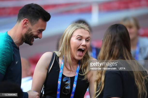 Katie Goodland fiance of Harry Kane shares a joke with Hugo Lloris of Tottenham Hotspur and his wife Marine Lloris during the Tottenham Hotspur...