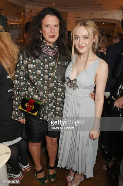 Katie Grand and Dakota Fanning attend the LOVE x Miu Miu Women's Tales dinner hosted by Katie Grand and Elle Fanning at Loulou's on February 19 2018...