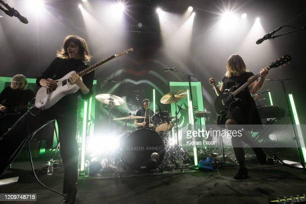Katie Harkin, Carrie Brownstein, Angie Boylan, and Corin Tucker of Sleater Kinney perform at Vicar Street on March 01, 2020 in Dublin, Ireland.