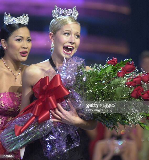 Katie Harman carries a giant bouquet of roses after being crowned Miss America 2002 by Miss America 2001 Angela Perez Baraquio September 22 2001 in...