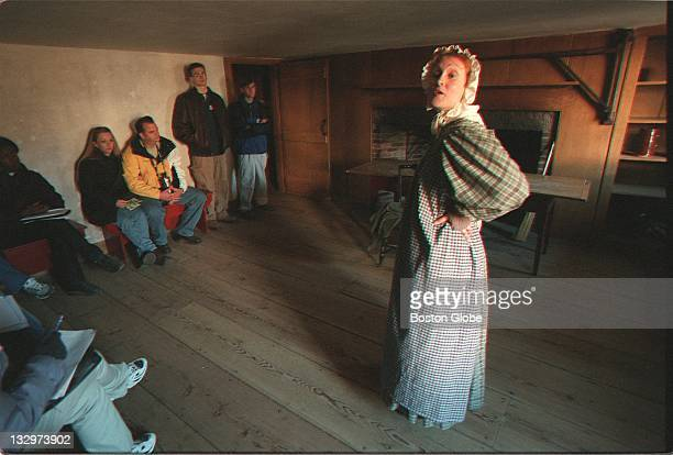 Katie Hill aka Mary Culligan talks to visitors at the Towne house in Sturbridge Village Mary plays the role of an Irish immigrant household help
