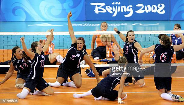 Katie Holloway and Brenda Maymon of USA celebrate a point during the Sitting Volleyball match between the USA and the Netherlands at China...