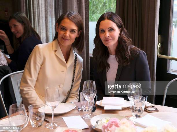 Katie Holmes and Courteney Cox both wearing Chanel at Through Her Lens The Tribeca Chanel Women's Filmmaker Program Luncheon at Locanda Verde on...