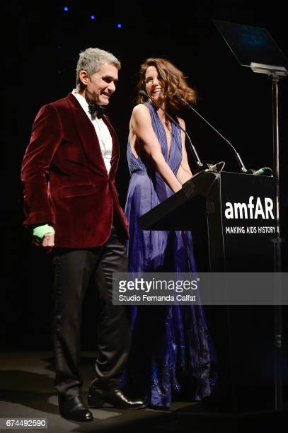 Katie Holmes and Felipe Diniz speak onstage during the 7th Annual amfAR Inspiration Gala on April 27 2017 in Sao Paulo Brazil
