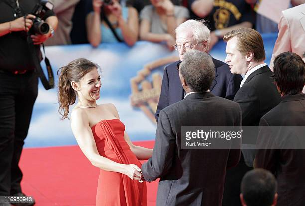 Katie Holmes and Morgan Freeman share a laugh as Michael Caine and Director Christopher Nolan look on