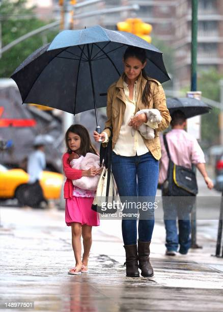Katie Holmes and Suri Cruise seen walking in the rain in Chelsea on July 20 2012 in New York City