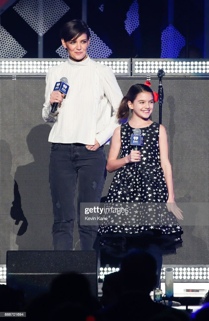 Katie Holmes (L) and Suri Cruise speak onstage during Z100's iHeartRadio Jingle Ball 2017 at Madison Square Garden on December 8, 2017 in New York City.