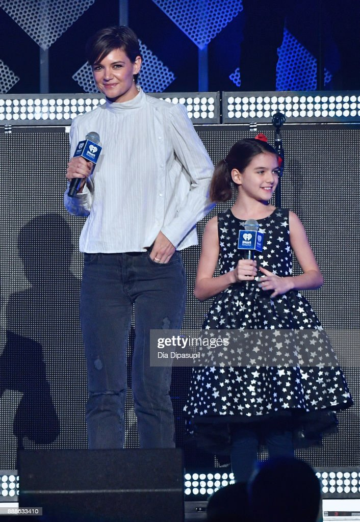 Katie Holmes and Suri Cruise speak performs onstage at the Z100's Jingle Ball 2017 on December 8, 2017 in New York City.