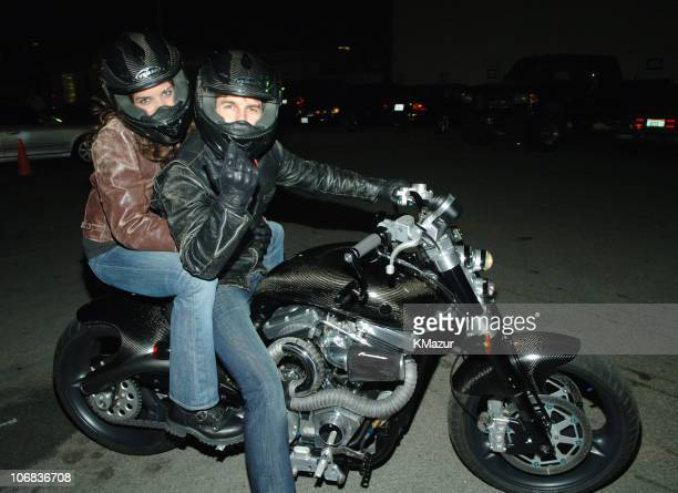Katie Holmes and Tom Cruise during Tom Cruise and Katie Holmes Depart the 2005 MTV Movie Awards at Shrine Auditorium in Los Angeles California United...