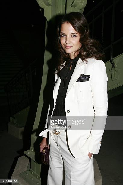Katie Holmes attends the Yves Saint Laurent Fashion Show the part of Paris Fashion Week Spring/Summer 2007 on October 5 2006 in Paris France