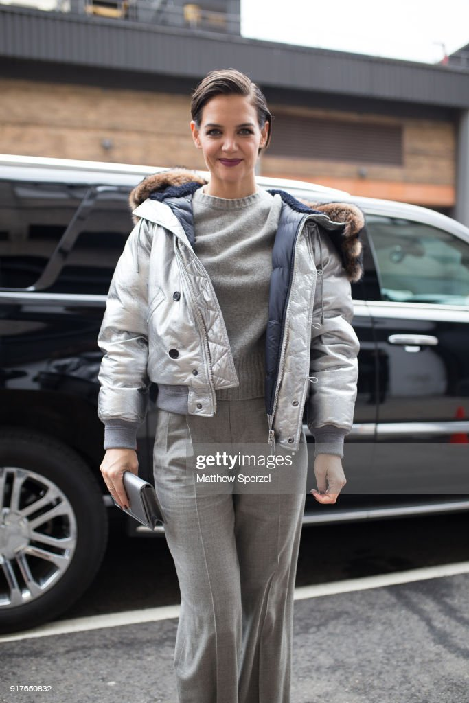 Katie Holmes is seen on the street attending Ralph Lauren during New York Fashion Week wearing a silver coat with grey sweater and pants on February 12, 2018 in New York City.