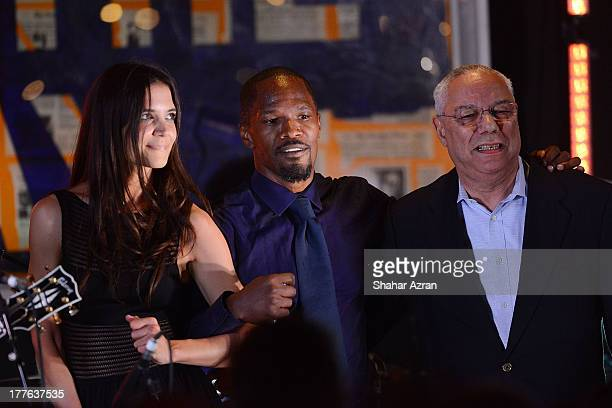 katie Holmes Jamie Foxx and Colion Powell perform at the 4th Annual Apollo In The Hamptons Benefit on August 24 2013 in East Hampton New York
