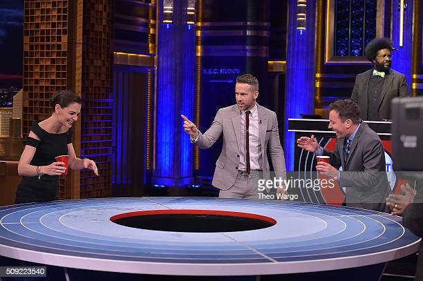 """Katie Holmes, Ryan Reynolds and Jimmy Fallon play a game of """"Musical Beers"""" during a taping of """"The Tonight Show Starring Jimmy Fallon"""" at NBC..."""