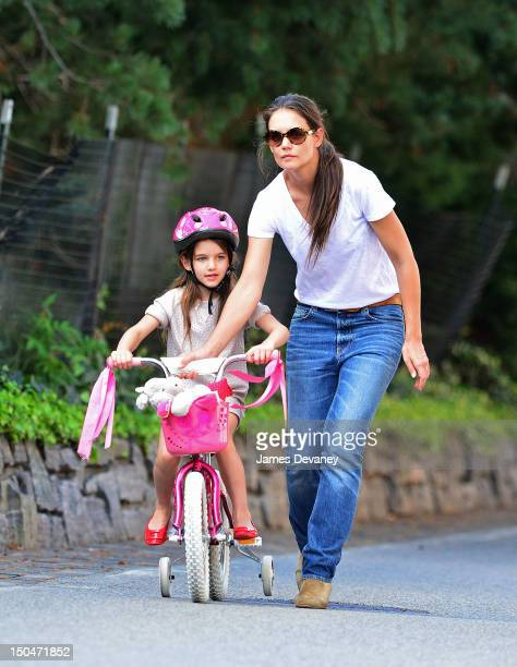 Katie Holmes takes Suri Cruise on a bike ride along Manhattan's West Side bike path on August 18 2012 in New York City