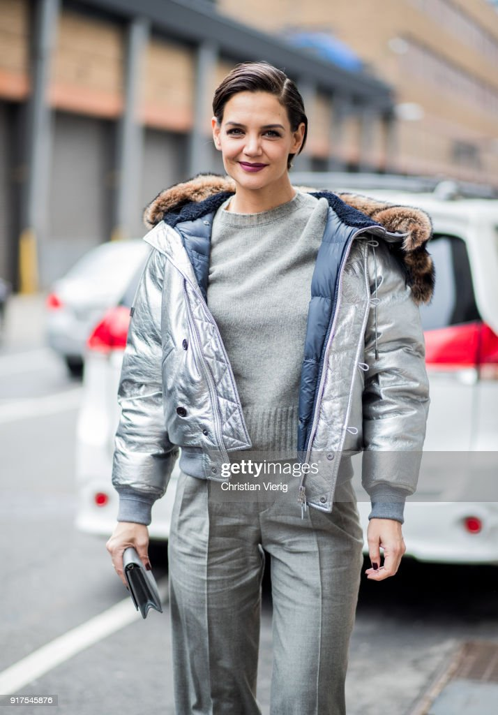 Katie Holmes wearing silver jacket outside Ralph Lauren seen on February 12, 2018 in New York City.