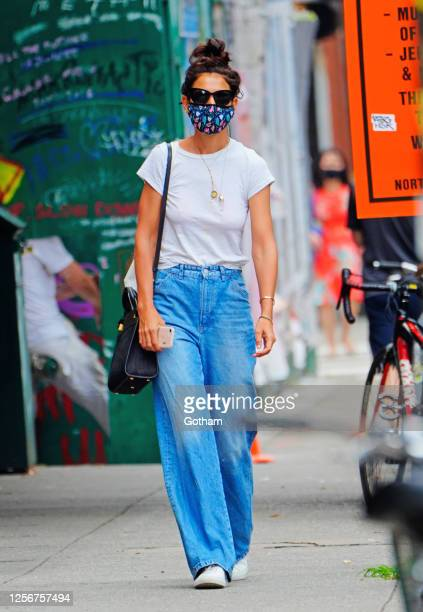 Katie Holmes wears a white top with denim jeans when out and about on July 17, 2020 in New York City.