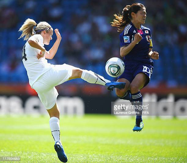 Katie Hoyle of New Zealand battles with Homare Sawa of Japan during the FIFA Women's World Cup 2011 match between Japan and New Zealand at the Fifa...