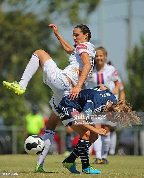 Katie Hoyle of the Victory and Kathryn Gill of the Glory compete for the ball during the round 11 WLeague match between Melbourne Victory and Perth...