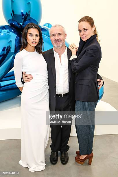 Katie Keight Damien Hirst and Stella McCartney attend a private dinner for Jeff Koons hosted by Damien Hirst at Newport Street Gallery on May 16 2016...