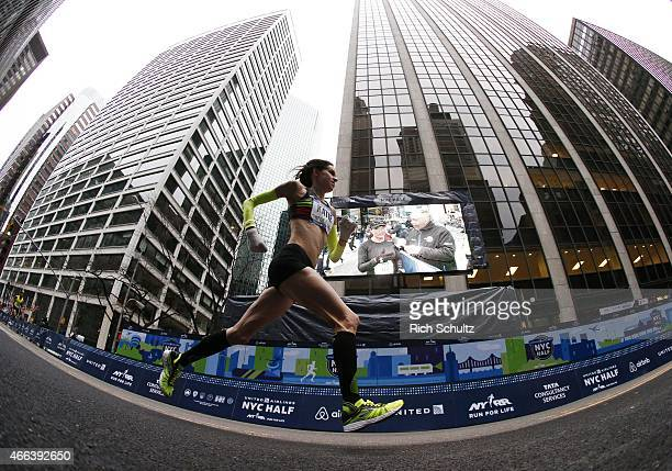 Katie Kellner of the United States runs the 2015 United Airlines New York City Half Marathon in lower Manhattan on March. 15, 2015 in New York City.