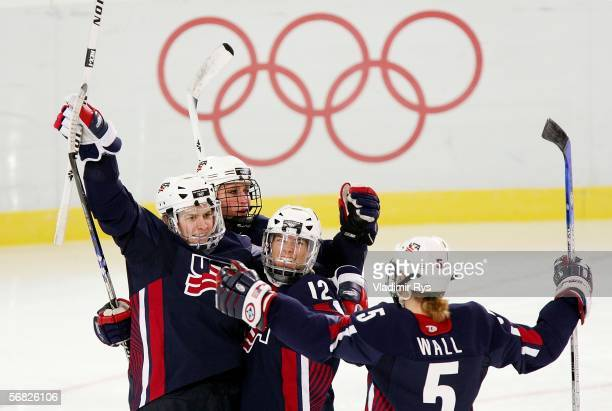 Katie King of the United States celebrates with teammates Lyndsay Wall Jenny Potter and Angela Ruggiero after King scored a goal against Switzerland...