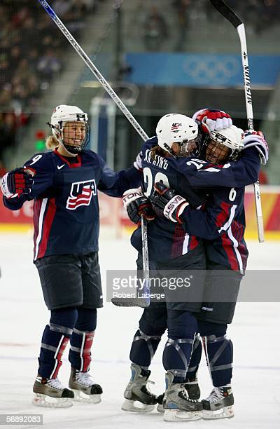 Katie King of the United States is congratulated by teammates Molly Engstrom and Helen Resor after scoring her second goal of the first period to...