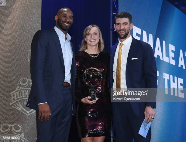 Katie Ledecky accepts Golden Goggle Award for Female Athlete of the Year from Michael Phelps and Kobe Bryant during the 2017 USA Swimming Golden...