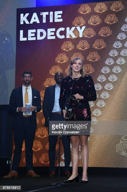 Katie Ledecky accepts Golden Goggle Award for Female Athlete with presenters Michael Phelps and Kobe Bryant looking on during the 2017 USA Swimming...