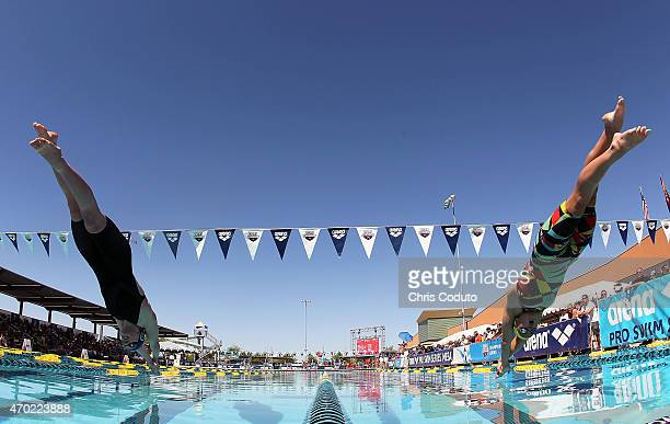 Katie Ledecky and Katie McLaughlin launch off the blocks in the 100m Freestyle Prelims during day four of the Arena Pro Swim Series at the Skyline...