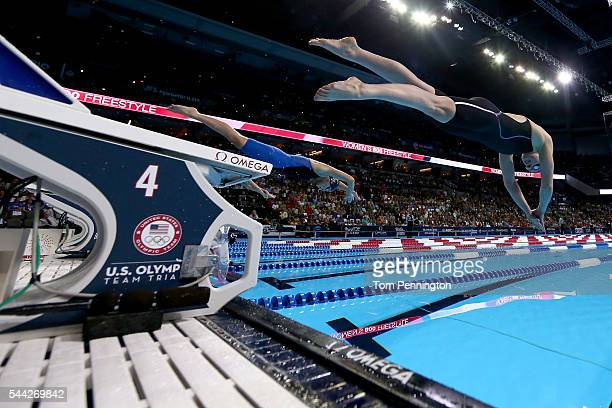 Katie Ledecky and Leah Smith of the United States dive in to compete in the final heat for the Women's 800 Meter Freestyle during Day Seven of the...