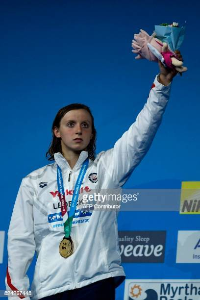US Katie Ledecky celebrates on the podium after the women's 800m freestyle final during the swimming competition at the 2017 FINA World Championships...