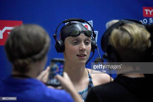 Katie Ledecky is interviewed after winning the women's 800 meter freestyle final during the fourth day of the TYR Pro Swim Series at Indiana...