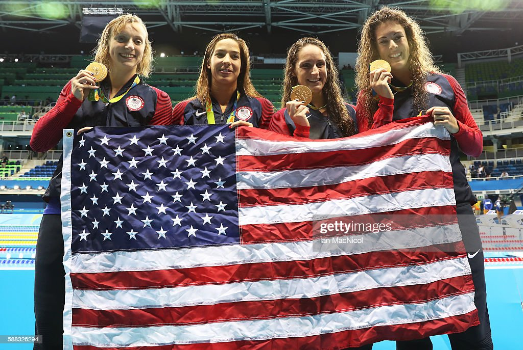 Katie Ledecky, Maya Dirado, Leah Smith and Allison Schimdt of United Statesvpose with their Gold medals from the Women's 4 x 20m Freestyle Relay on Day 5 of the Rio 2016 Olympic Games at the Olympic Aquatics Stadium on August 10, 2016 in Rio de Janeiro, Brazil.