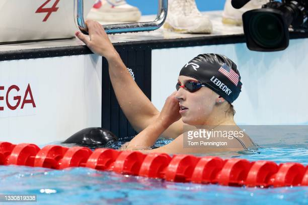 Katie Ledecky of Team United States reacts after competing in the Women's 200m Freestyle Semifinal on day four of the Tokyo 2020 Olympic Games at...