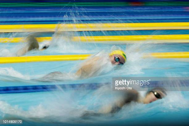 Katie Ledecky of the United States Ariarne Titmus of Australia and Emily Overholt of Canada compete in the Women's 400m Freestyle Final on day three...