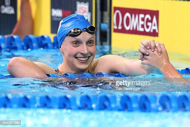 Katie Ledecky of the United States celebrates after finishing first in the final heat for the Women's 800 Meter Freestyle during Day Seven of the...