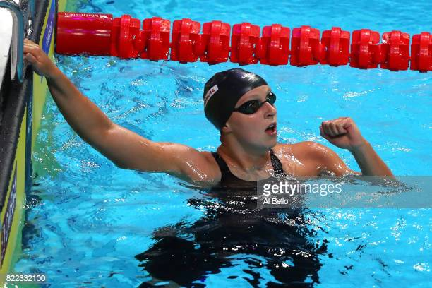 Katie Ledecky of the United States celebrates after winning the gold medal during the Women's 1500m Freestyle final on day twelve of the Budapest...