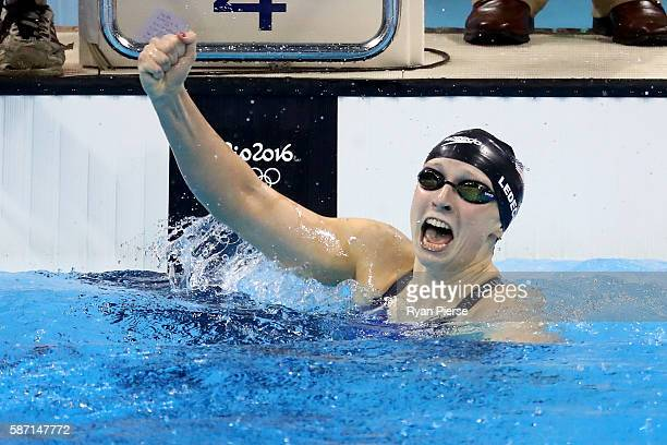 Katie Ledecky of the United States celebrates winning gold and setting a new world record in the Women's 400m Freestyle Final on Day 2 of the Rio...