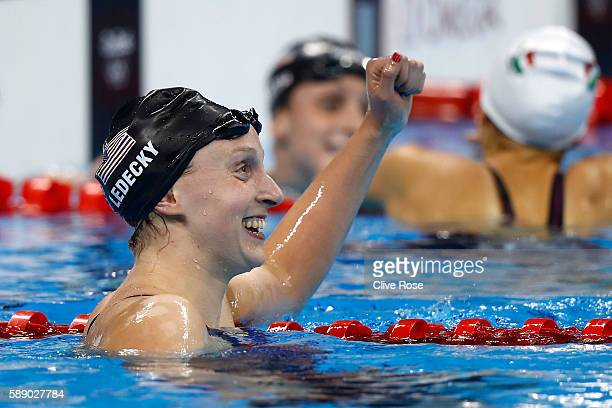 Katie Ledecky of the United States celebrates winning gold and setting a new world record in the time of 80479sec in the Women's 800m Freestyle Final...