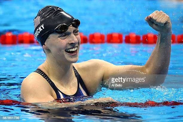Katie Ledecky of the United States celebrates winning gold in the Women's 200m Freestyle Final on Day 4 of the Rio 2016 Olympic Games at the Olympic...