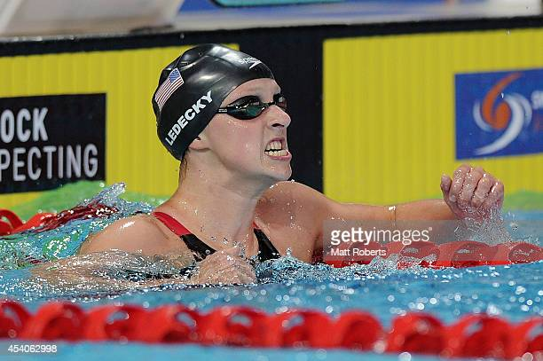 Katie Ledecky of the United States celebrates winning the Women's 1500m Freestyle Final during day four of the 2014 Pan Pacific Championships at Gold...