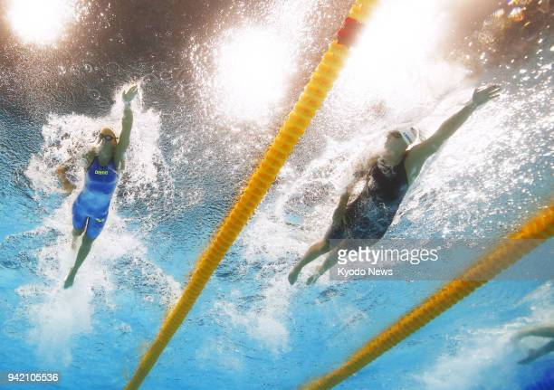 Katie Ledecky of the United States competes in the women's 400meter freestyle heats at the world swimming championships in Budapest on July 23 2017...