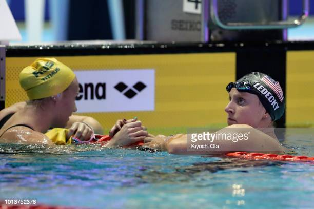Katie Ledecky of the United States is congratulated after winning the gold medal by Ariarne Titmus of Australia after competing in the Women's...