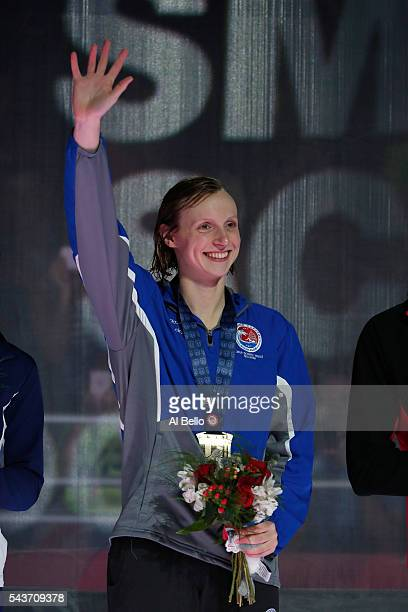 Katie Ledecky of the United States participates in the medal ceremony for the Women's 200 Meter Freestyle during Day Four of the 2016 US Olympic Team...