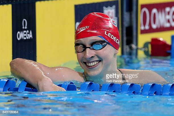 Katie Ledecky of the United States reacts after competing in a final heat for the Women's 200 Meter Freestyle during Day Four of the 2016 US Olympic...
