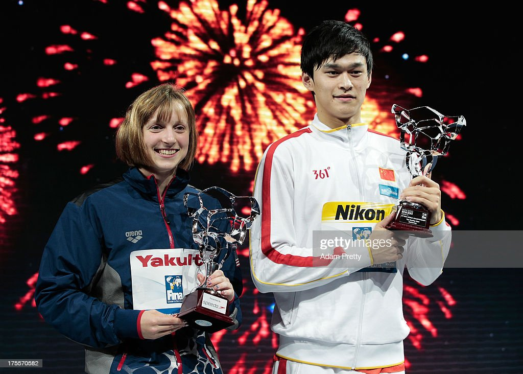 Katie Ledecky of the USA (L) and Yang Sun of China celebrate on the podium with their awards for Best Swimmers on day sixteen of the 15th FINA World Championships at Palau Sant Jordi on August 4, 2013 in Barcelona, Spain.