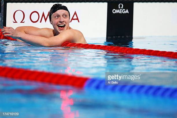 Katie Ledecky of the USA celebrates after winning the Swimming Women's400mFreestyle Final on day nine of the 15th FINA World Championships at Palau...